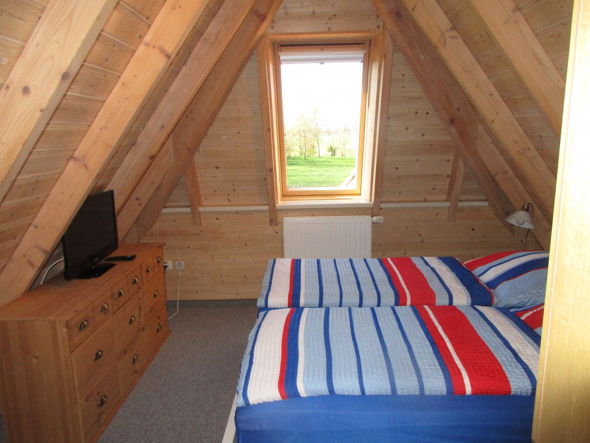 Schlafzimmer im 1. OG mit Doppelbett
